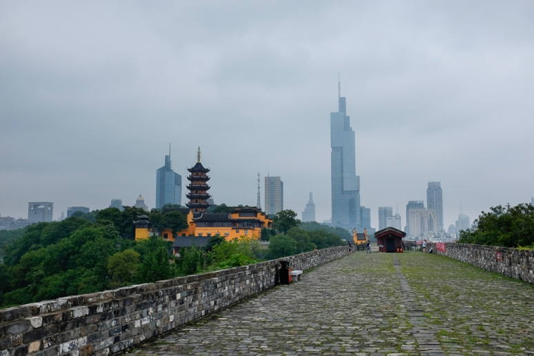 On the city wall you can see the new and the old China.