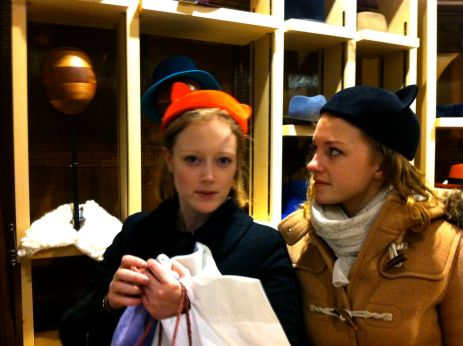 Trying on silly hats in a posh expensive shop